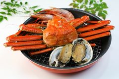 Marine products helping of various kinds of dishes. I served an abalone, a deep red snow crab, red prawns to a colander Stock Photo