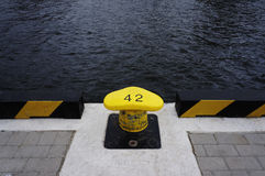 Marine puller. Yellow marine puller number 42 in a pier in a port royalty free stock photos