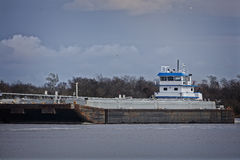 Marine push boat or tug boat in river with barge Royalty Free Stock Photos