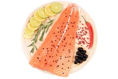 Marine raw fish fillets decorated. On a wooden table Stock Photos