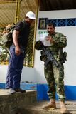 The marine on the river Guaviare checks documents. Military forces of Colombia supervise territories where guerrillas of FARC still act Royalty Free Stock Images