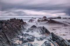 Marine rocks in diffuse waves. Royalty Free Stock Photography