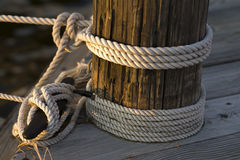 Marine Rope. Rope tied to a pier and a cleat at a boatyard Royalty Free Stock Images
