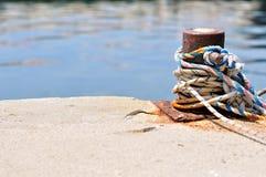 Marine rope on mooring bollard Stock Photos