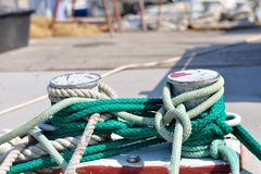 Marine rope on mooring bollard in port Royalty Free Stock Photos