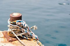 Marine rope on mooring bollard in port Royalty Free Stock Photo