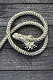 Marine rope over gray aged teak wood royalty free stock photos