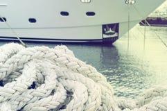 Marine ropes on the dock. Stock Photo