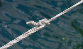 Marine ropes with knot Royalty Free Stock Photo