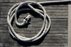 Marine round thread over dried teak wood royalty free stock photo