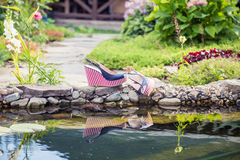 Marine sandals lie beside the pool. A Royalty Free Stock Images