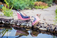 Marine sandals lie beside the pool. A Royalty Free Stock Photo