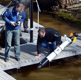 The marine scientists launch an Autonomous underwater unmanned vehicle. MOSCOW, RUSSIA - APRIL 25, 2014:The marine scientists launch an Autonomous underwater royalty free stock images