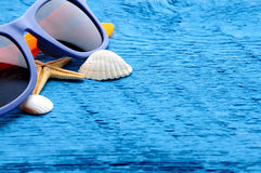 Marine sea background with shells and sunglasses Stock Photography