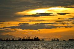 Marine in the sea with sunset sky Stock Images