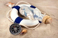 Marine still life. Few marine items on a sand in marine still life theme Stock Photography