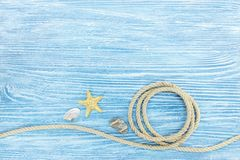Marine Stones And Seashells, Rope On Painted Blue Wooden Boards Stock Photo