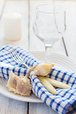 Marine style table setting with candle and seashells Stock Photo