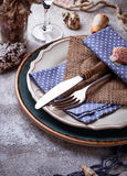 Marine style table setting with sea shells, fishnet and rope Stock Photos