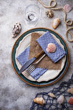 Marine style table setting with sea shells, fishnet and rope Stock Image