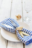 Marine style table setting on a white background with boards.  Stock Photography