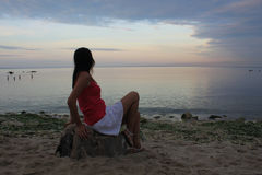 Marine sunset and a young woman Royalty Free Stock Images