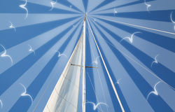 Marine theme art photo collage with mast and sail of yacht on bl. Ue sky background (used only my photo and brushes Stock Image