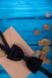Marine theme blue background. Tie bow and money from the mail envelope Stock Photo
