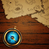 Marine theme, compass and old map. On the wooden table, this illustration may be useful as designer work Royalty Free Stock Images