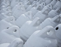 Marine themes, white buoys on the shore in the winter. Royalty Free Stock Photography