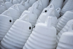 Marine themes, white buoys on the shore in the winter. Close up Stock Photo