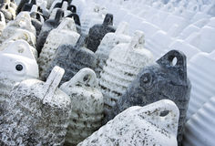 Marine themes, white buoys on the shore in the winter. Close up Stock Images