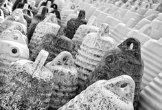 Marine themes, white buoys on the shore in the winter. Close up. Black and white Royalty Free Stock Images