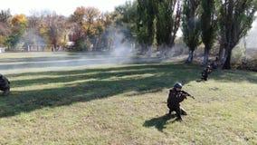 Marine training officer watching three trainees do pushups on firing range
