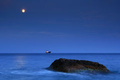 Marine trio. Moonrise over the ocean near a tropical island Stock Images