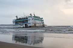 Marine Vessel Run Aground. Marine vessel, an offshore casino, that run aground near Miramer beach in Goa, India, waiting for rescue stock images