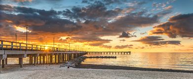 Marine walking pier in Palanga, Lithuania. The photo was taken at colorful sunset in Palanga - famous Baltic resort in Lithuania Stock Images