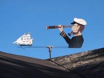 Marine weather vane. Shaped like a sailor blue sky background stock photo