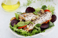 Marine white fish baked with vegetables Royalty Free Stock Image