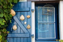 Marine window. Wooden blue window with hanging ropes in the old port of Biarritz Royalty Free Stock Images
