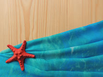 Marine wooden background with blue cloth pareo. Royalty Free Stock Photo