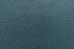 Marineblau-Farbkörnige, starke Kornkalbkuhlederbeschaffenheit und Hintergrund lizenzfreie stockfotos