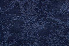 Marineblauwe achtergrond van een zacht stofferings textielproduct, close-up Stock Afbeelding