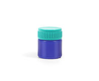 Marineblauwe plastic geneeskundefles Stock Foto's