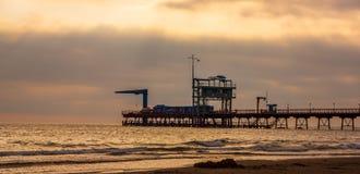Marinepijler bij zonsondergang Royalty-vrije Stock Foto's