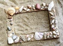 Marinerahmen im Sand Stockfotografie