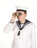 Marinero joven con los prismáticos Imagen de archivo libre de regalías