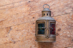 A mariners lamp on an old wood floor Royalty Free Stock Photo