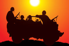 Marines. Silhouette of soldiers on the vehicle Royalty Free Stock Images