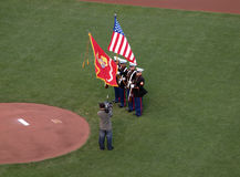 Marines hold flags during national anthem Stock Image